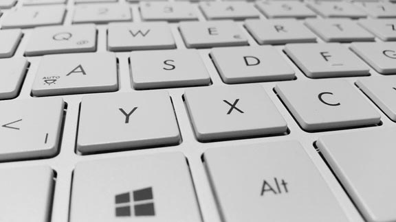 A close-up shot of a white keyboard, illustrating the concept of keyboard shortcuts