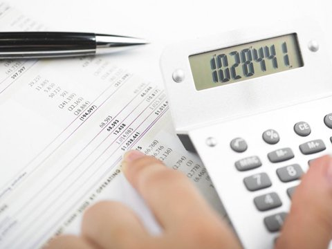 an accountant manually filling in payroll information
