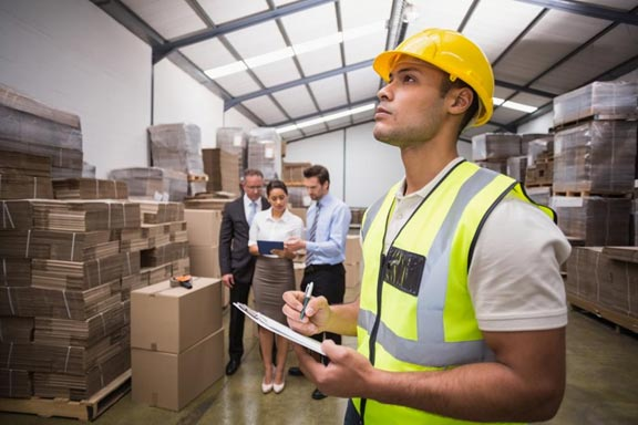 An employee checking inventory at a warehouse