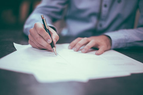 a lawyer reviewing and signing legal documents