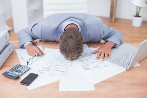 a businessperson frustrated by the tedious accounting processes