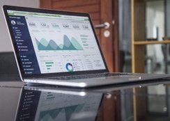 Accounting graphs and dashboards on a laptop