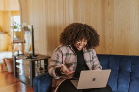 A Microsoft employee attending a remote meeting from home