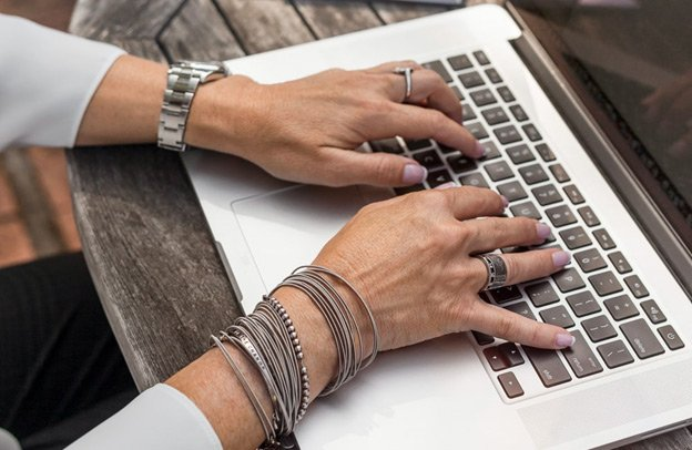 : An employee using QuickBooks on her personal laptop