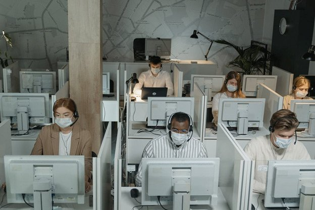 Employees working at a data center after COVID