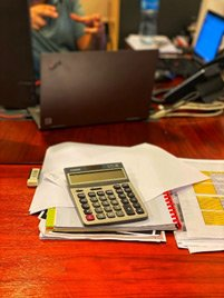 A CPA's desk with calculators and lots of paperwork
