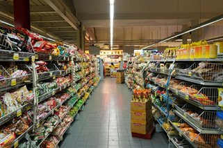 A supermarket aisle with stocked shelves